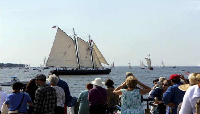 "Sails in the sun:  At Gloucester's Parade of Sail the Columbia stands at full sail, as if in a Fitz Henry Lane painting, one of the largest of 25 schooners that ride the wind and waves in a parade described by festival Chairwoman Daisy Nell Collinson as a ""water ballet"